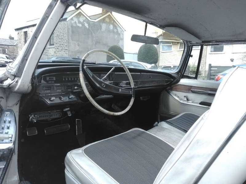 197015