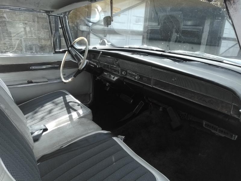 197023